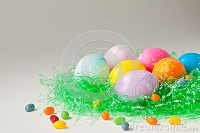 Brightly decorated easter eggs and jelly beans