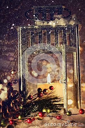 Brightly lit lantern in the snow