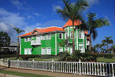 Brightly painted green clapboard building
