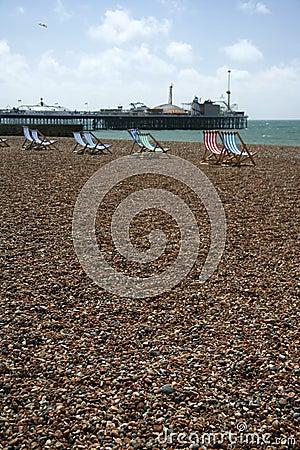 Brighton beach deckchairs palace pier