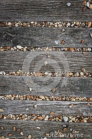 Brighton beach pebbles wooden boards background