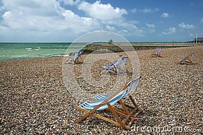 Brighton beach striped deckchairs sussex england