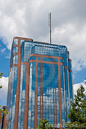 Brilliant Blue Sky Reflected in Glass Office Tower