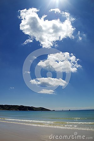 Brilliant sunshine and clouds over beach