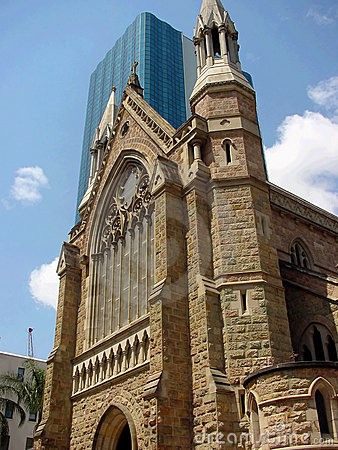 Brisbane cathedral overlapping a modern glass skyscraper