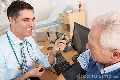 British doctor taking man s blood pressure