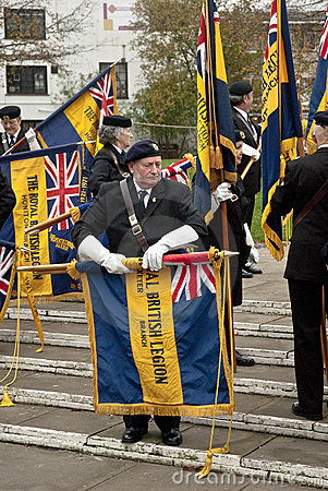 British Legion flags are rolled away by Ex-service Editorial Photo