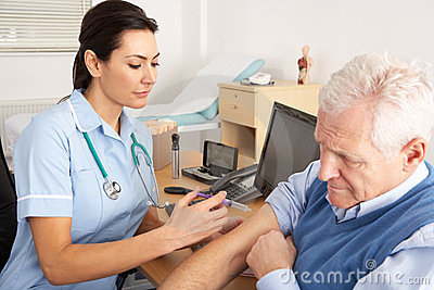 British nurse giving injection to senior man