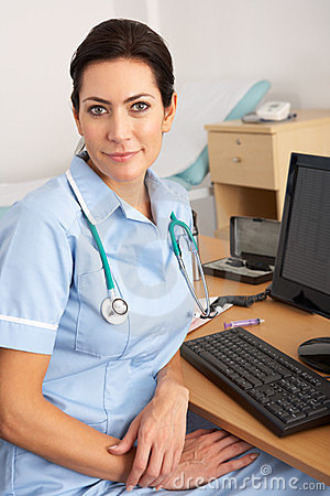 British nurse sitting at desk at work
