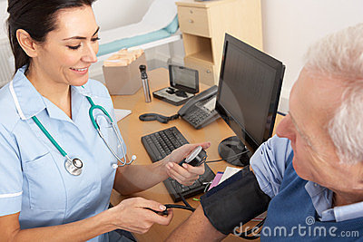 British nurse taking senior man s blood pressure