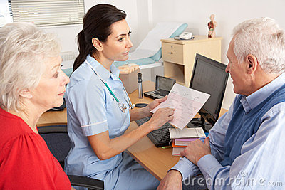 British nurse talking to senior couple