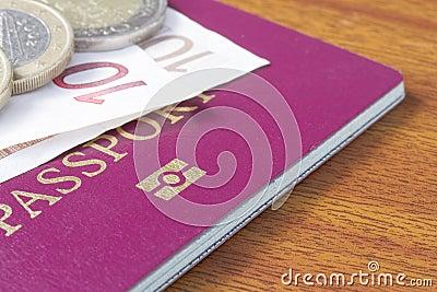 British passport with Euro coins