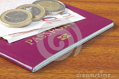 British passport with Euro coins and notes
