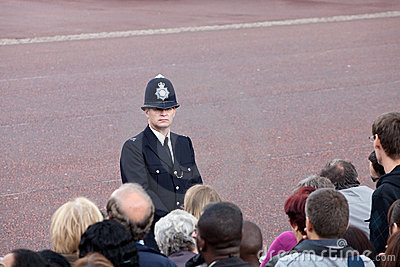 British policeman observes crowd Editorial Stock Photo
