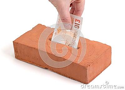 British Pound deposit into building brick