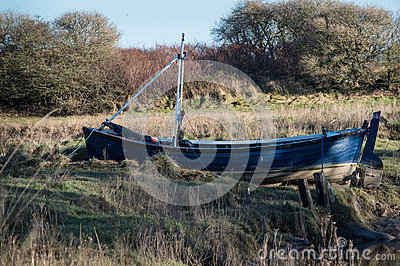 A British riverbank with boat