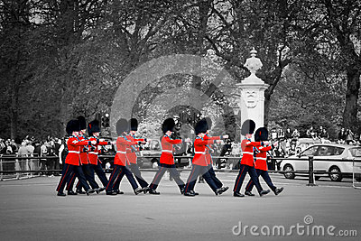 British Royal guards perform the Changing of the Guard in Buckingham Palace Editorial Stock Photo