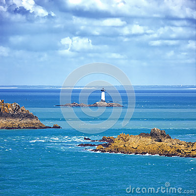 Brittany ocean panorama, islands and lighthouse Point du Grouin. Cancale, France