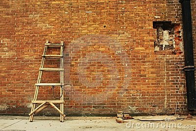 Broke  brick wall and ladder