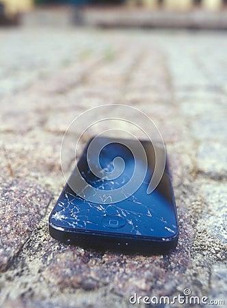 Broken Apple mobile device. Editorial Photo
