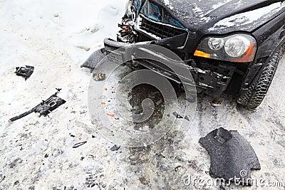 Broken black car on road in winter