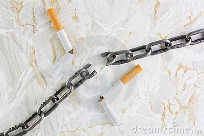 Broken chain over marble texture and cigarettes