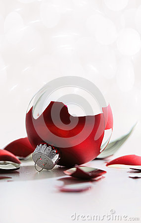 Broken christmas ball isolated on white