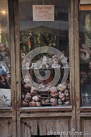 Broken dolls behind glass