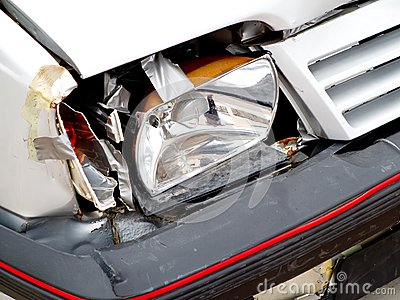 Broken front headlight on white car