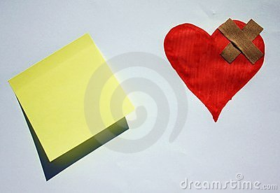 Broken heart with a post it note