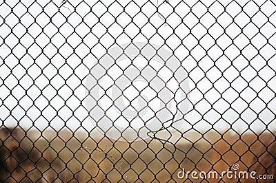 Broken iron wire fence