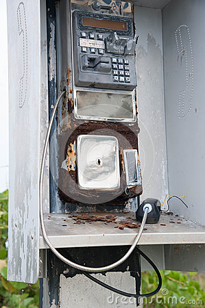 Free Broken Pay Phone Handset And Coin Return Stock Image - 55338081