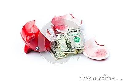 Broken piggy bank with coins