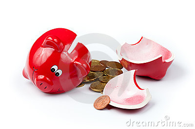 Broken piggy bank with coins on white