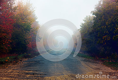 Broken road in fog