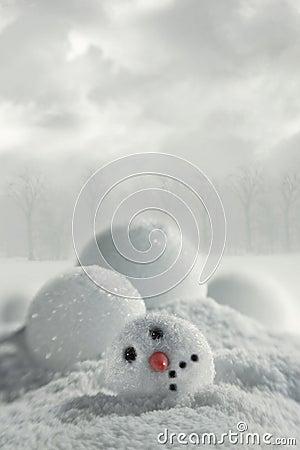 Broken snowman in snow