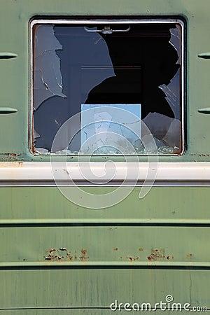 Broken window of old rusty train