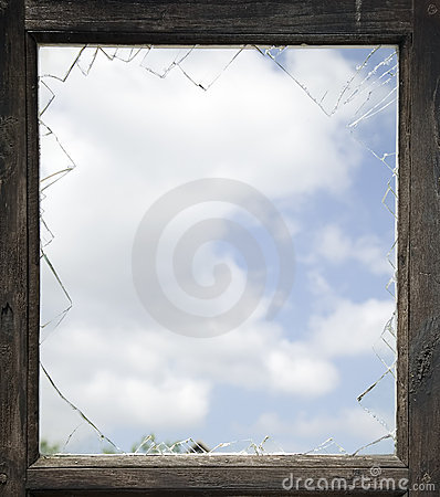 Broken window with old wooden frame