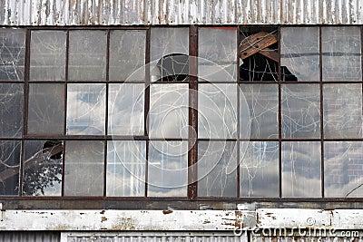 Broken windows at abandoned factory building