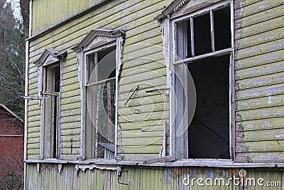 Broken windows of abandoned house
