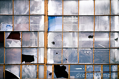 Broken windows of old industrial building