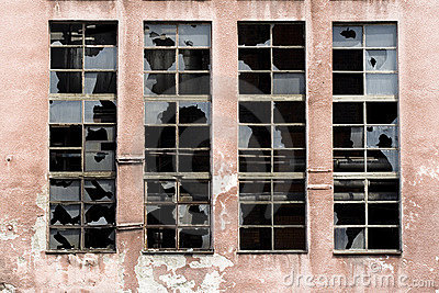 Broken windows on old warehouse