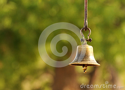 Bronze bell on green