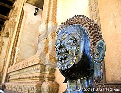 Bronze Buddha statue at the Haw Phra Kaew