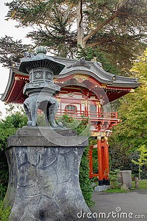 Bronze Lantern by Pagoda in Japanese Garden
