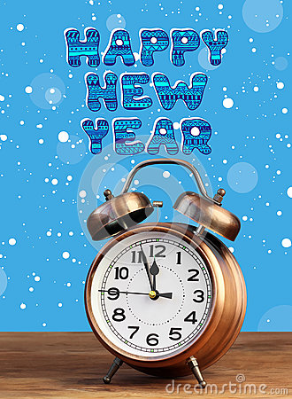 Free Bronze Retro Alarm Clock At Twelve O`clock Amid Flying Snow. Stock Photography - 82206312
