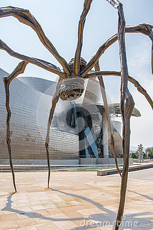Bronze sculpture and Guggenheim Museum in Bilbao Editorial Stock Photo