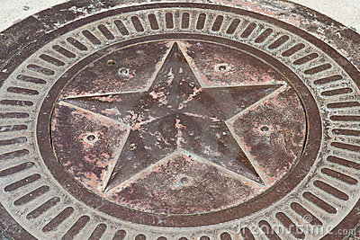 Bronze star with patina