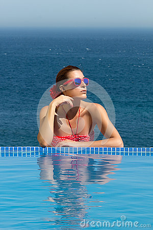 Bronzed Beauty. Poolside Girl. Woman in Red