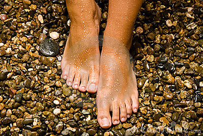 Bronzed feet on stones
